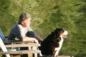 Relaxing on the dock, watching the lake with your dog.